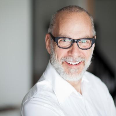 Hoya-Vision-progressive-lenses-old-man-smiling-with-black-frames